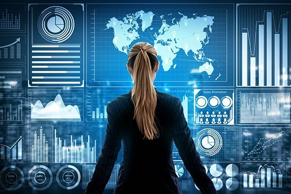 woman looking at charts representing breadth of options available with Tristar's API